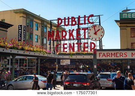 SEATTLE WA - SEPTEMBER 11 2016: The Pike Place Market with its famous sign and clock attracts large crowds of visitors every day.