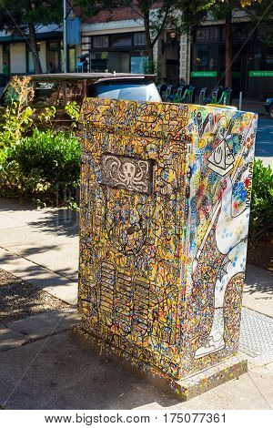 SEATTLE WA - SEPTEMBER 11 2016: A graffiti-covered traffic signal control box in the Belltown neighborhood displays a unique example of this city's hip urban art.