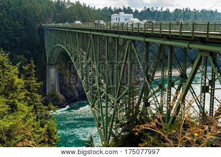ROSARIO BEACH WA - SEPTEMBER 18 2016: The high bridge carrying Washington Rt. 20 from Whidby Island spans the roiling waters of Deception Pass between Skagit Bay and the Salish Sea.