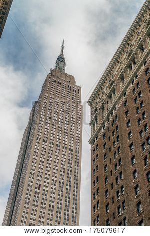 NEW YORK CITY, USA - AUGUST 12, 2016: Empire State Building view from the Herald Square. The Empire State Building is an American cultural icon. It is designed in the distinctive Art Deco style.