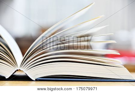 Hardcover Book Lying On The Table In A Library