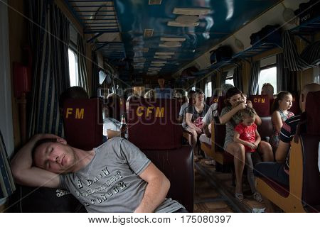 TIRASPOL TRANSNITRIA (MOLDOVA) - AUGUST 13 2016: Young man sleeping in a passenger car of the Chisinau-Odessa (Moldova to Ukraine) train route passing through the breakaway republic of Transnistria and its capital city Tiraspol