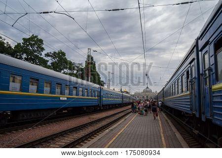 ODESSA UKRAINE - AUGUST 13 2015: People boarding a train on the platforms of Odessa train station