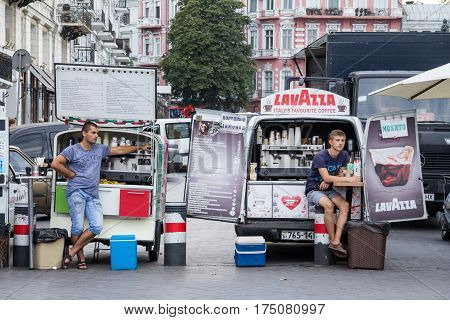 ODESSA UKRAINE - AUGUST 13 2015: Mobile Coffee trucks and vans selling espresso on the main street of Odessa. Coffee vans are a typical part of the urban scene of Ukrainian cities