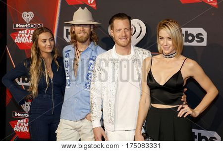 Brittney Marie Cole, Brian Kelley, Tyler Hubbard and Hayley Stommel of Florida Georgia Line at the 2017 iHeartRadio Music Awards held at the Forum in Inglewood, USA on March 5, 2017.