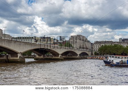LONDON, ENGLAND - JUNE 15 2016: Waterloo Bridge and Thames River, London, England, United Kingdom
