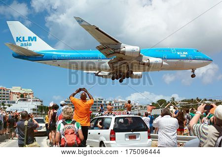Big Plane Landing Under Heads Of People
