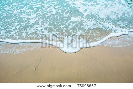 Tropical beach in Thailand,Sea foam on beach,soft wave of blue ocean on Sandy beach