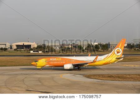 BANGKOK THAILAND - MARCH 7 2017: Boeing 737-88L (WL) company Nok Air scrolls across the Runway. Nok Air Plane landed at Don Mueang International Airport. Nok Air is a major domestic low-cost airline in Thailand.