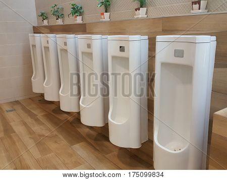 Male public toilets white color in market