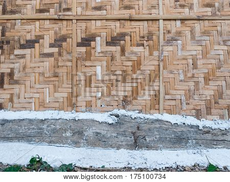 Closeup To Weaving Rattan Wall With Wood And Concrete Background