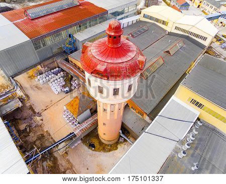 Aerial view of water tower for industrial use in factory. Architecture and industry from above.