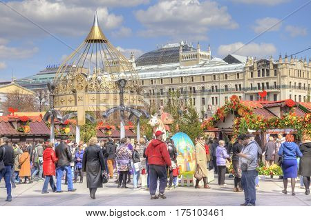 MOSCOW RUSSIA - April 24.2016: Citizens and tourists at the festive Easter Fair on the Revolution Square in the city center
