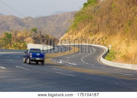 CHIANG RAI THAILAND - FEBRUARY 20 : Curve asphalt highway in the mountain with vehicles Thailand on February 20 2016 in Chiang rai Thailand.