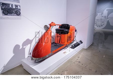 Los Angeles CA USA -- March 4 2017: Orange 1947 Salsbury Model 85 Streamlined scooter from Bill Kling at the Petersen Automotive Museum in Los Angeles California United States. Editorial only.