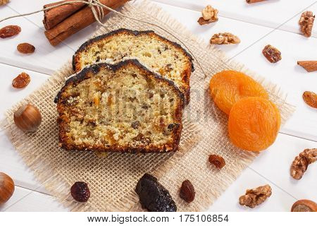 Fresh Baked Fruitcake With Ingredients On Boards