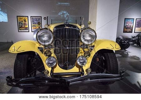 Los Angeles, CA, USA -- March 4, 2017: Yellow 1984 Duesenberg II SJ driven in the move The Great Gatsby at the Petersen Automotive Museum in Los Angeles, California, United States. Editorial only.