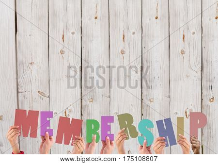 Hands holding membership word against wooden background