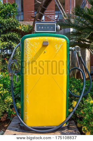 An old rusty and vintage gasoline pump which out of service