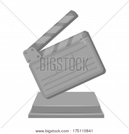 Gold clapperboard on stand.Award for best Director.Movie awards single icon in monochrome style vector symbol stock web illustration.