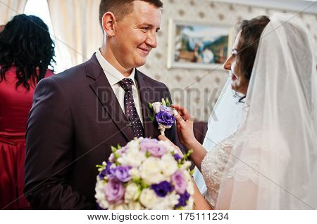 Bride Instilled Buttonhole In Groom Jacket  At Wedding Day On First Meeting.