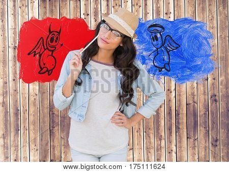 Digital composite image of woman standing between the good and bad conscience