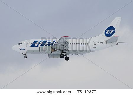 ST. PETERSBURG, RUSSIA - FEBRUARY 25, 2017: The Boeing 737-500 (VP-BVL) plane of Utair airline flying in the cloudy sky close up