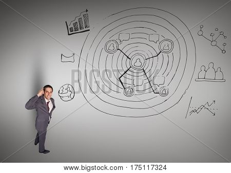 Digital composition of thoughtful businessman with business doodles against grey background