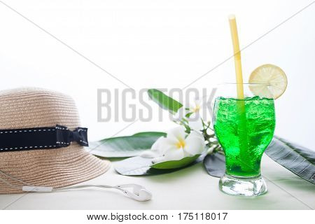 Iced green color drink on white background with plumeria flower Summer concept with copy space