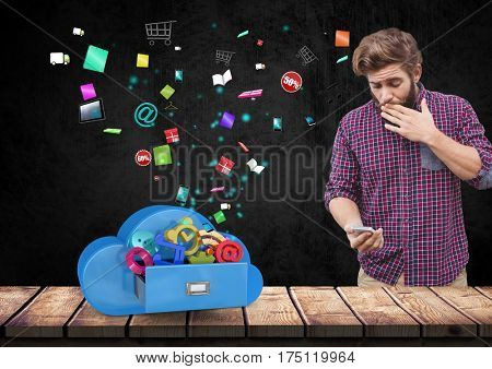 Digital composition of suprised man using mobile phone against app icons in background