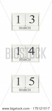 Closeup group of white wooden calendar with black 13 14 15 march word three date calendar isolated on white background