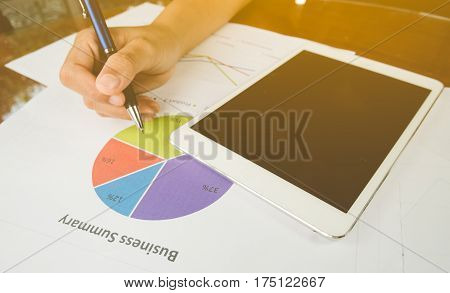 Working Woman Holding Pen And Teblet On Bussiness Report .