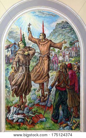 SHKODER, ALBANIA - SEPTEMBER 30: Frescoes that depict the persecution of religion in socialist Albania, St Stephen's Cathedral in Shkoder, Albania on September 30, 2016.