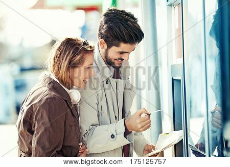 Tourists Taking Money From Atm