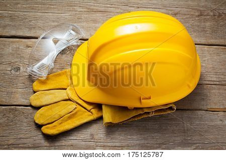 Yellow safety helmet and safety glasses