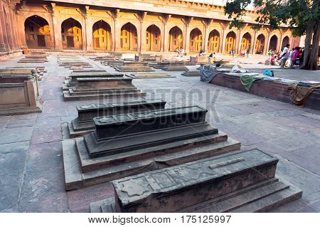 Muslim stone grave in Fatehpur Sikri. India. The red Fort. A sacred place. an outdoor courtyard in the ancient Mughal city of Fatehpur