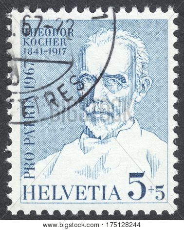 MOSCOW RUSSIA - CIRCA FEBRUARY 2017: a post stamp printed in SWITZERLAND shows a portrait of Kocher Theodor (1841-1917) a surgeon & nobel laureate the series