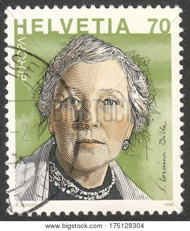 MOSCOW RUSSIA - CIRCA FEBRUARY 2017: a post stamp printed in SWITZERLAND shows a portrait of Corinna Bille (1912-79) a writer the series