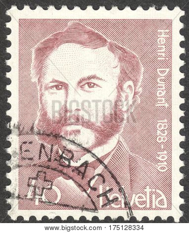 MOSCOW RUSSIA - CIRCA FEBRUARY 2017: a post stamp printed in SWITZERLAND shows a portrait of Henri Dunant a philantropist the founder of the Red Cross the series
