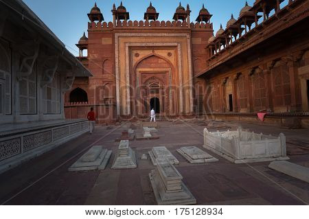 Muslim stone grave in Fatehpur Sikri. India. the inner courtyard of the Fort. An outdoor courtyard in the ancient Mughal city of Fatehpur