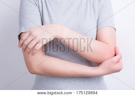 Asians woman with elbow pain on white background