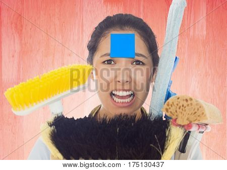 Digital composition of a frustrated woman with various cleaning brushes