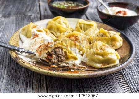 Traditional Turkish Manti with Joghurt and Vinegar as close-up on a plate