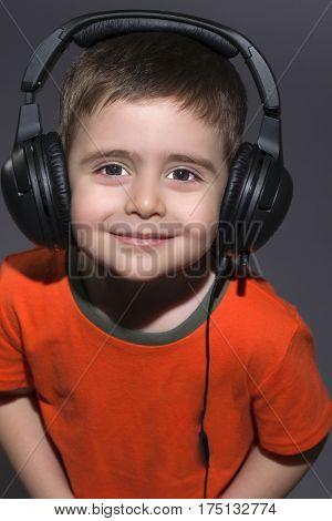Cute Little Boy listening to music on headphones