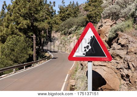 Road sign falling stones, Traffic sign caution possible falling rocks from the mountains