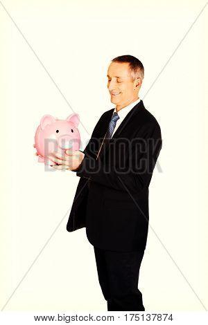 Businessman with big piggybank