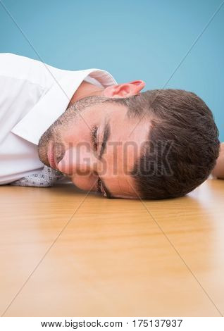Close-up of man resting his head on desk