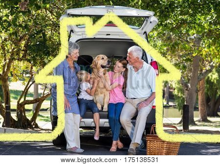 Digital composition of happy family with pet dog overlaid with house enjoying picnic