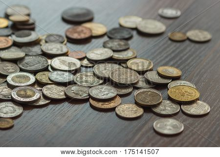 Different Gold And Silver Collector's Coins On The Wooden Table