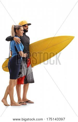 Full length profile shot of a female and a male surfer with a surfboard isolated on white background